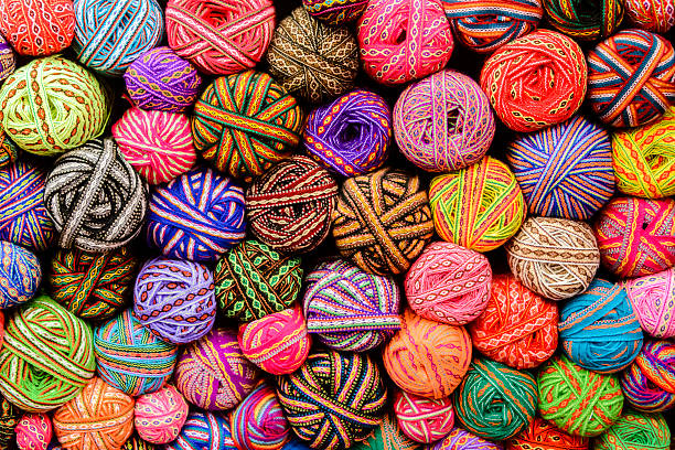 Colorful balls of yarn and ribbons stock photo