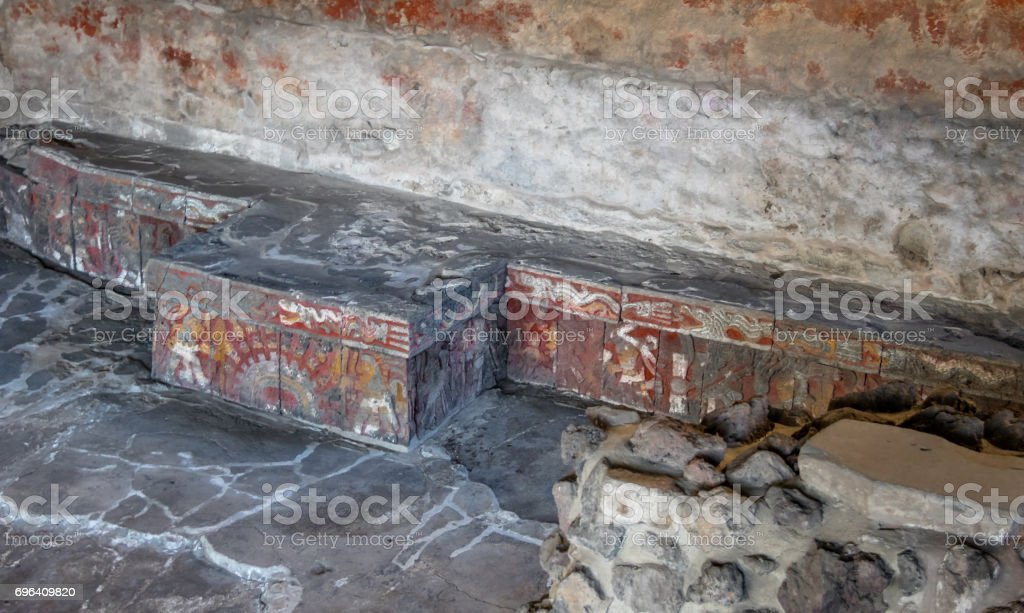 Colorful bas relief carving in stone benches of Aztec Temple (Templo Mayor) at ruins of Tenochtitlan - Mexico City, Mexico stock photo