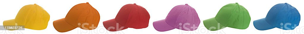 Colorful baseball caps in a row royalty-free stock photo