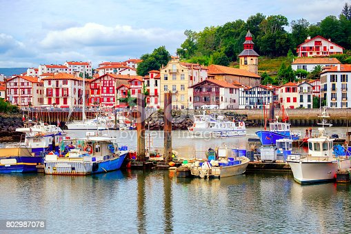 Traditional half-timbered basque houses in port of St Jean de Luz, on the atlantic coast of France