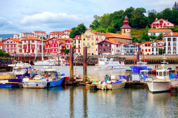 Colorful basque houses in port of Saint-Jean-de-Luz, France stock photo