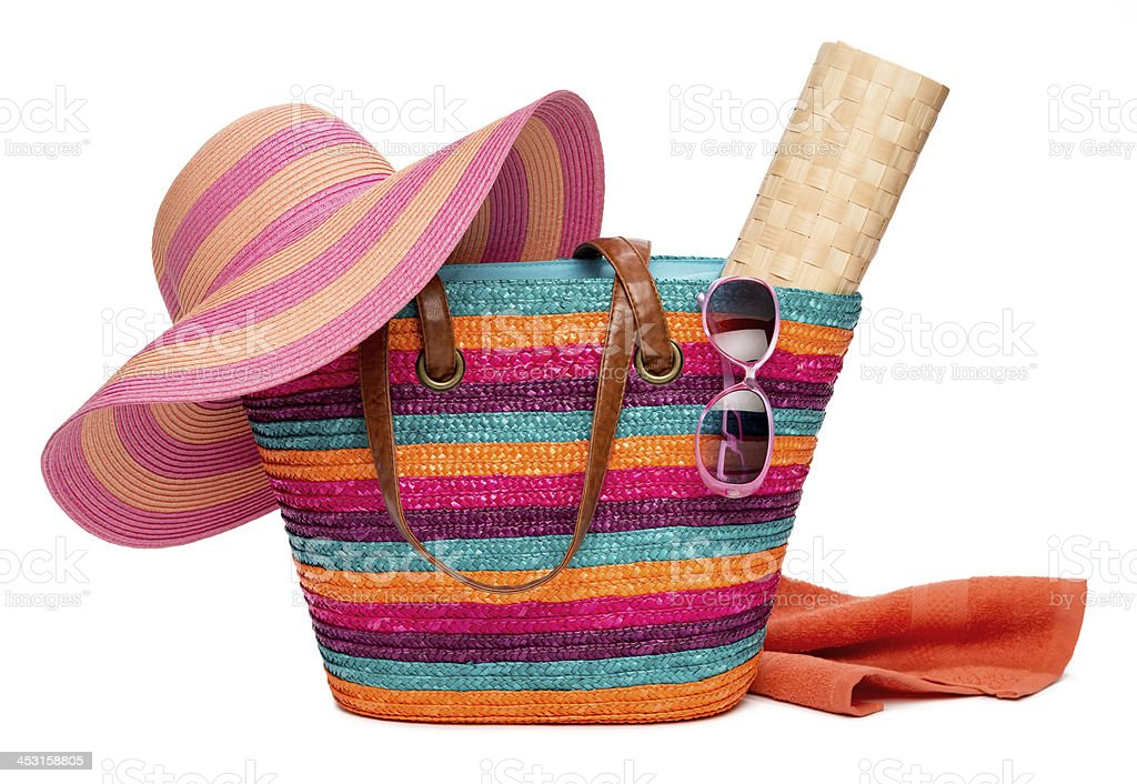 Colorful beach bag with hat sun mat towel and sunglasses stock photo
