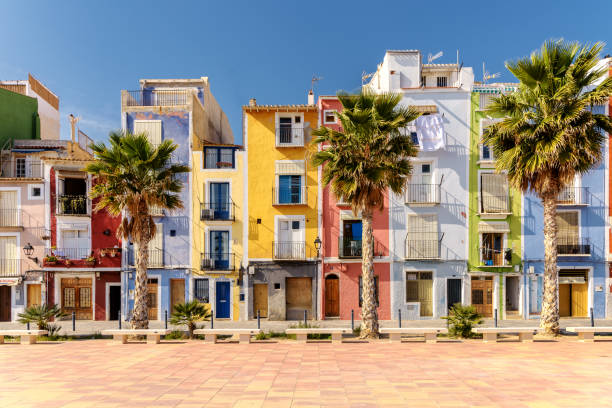 Colorful beach homes in Mediterranean Villajoyosa, Southern Spain Colorful beach homes in Villajoyosa, a charming Mediterranean village in Alicante, Southern Spain holiday villa stock pictures, royalty-free photos & images