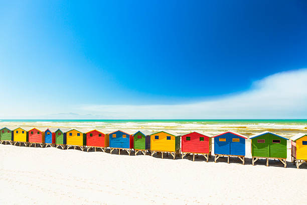 Colorful beach houses in Muizenberg, Cape Town, South Africa. Row of colorful beach houses in Muizenberg near Cape Town, South Africa.  beach hut stock pictures, royalty-free photos & images