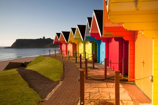Colorful Beach Huts Near Ocean Stock Photo - Download Image Now