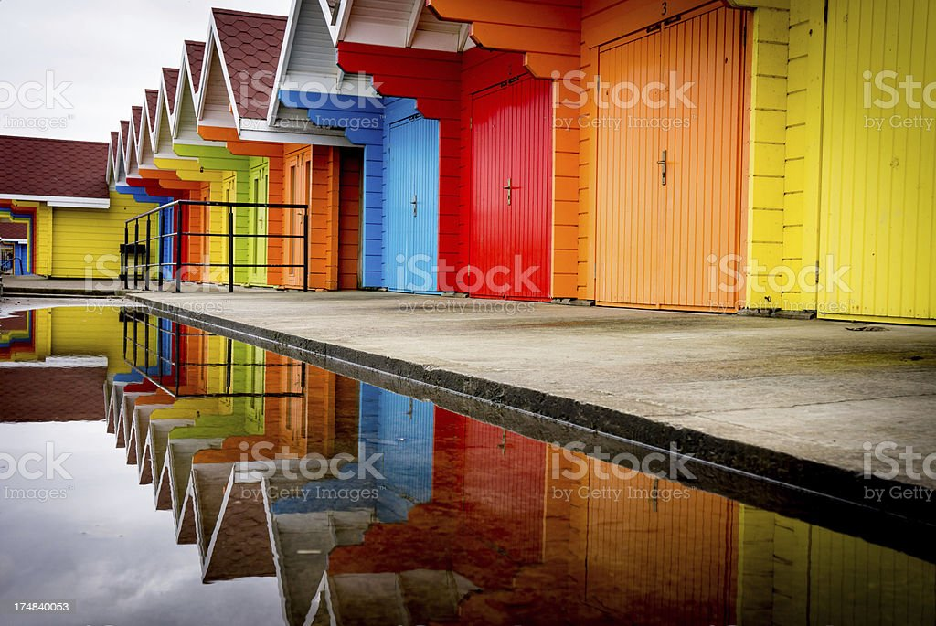 Colorful beach huts with reflections stock photo