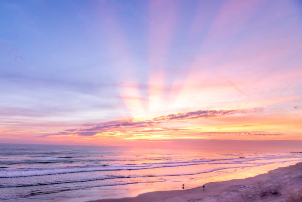 Colorful beach sunrise with sunrays shot in Fort Lauderdale, Florida stock photo