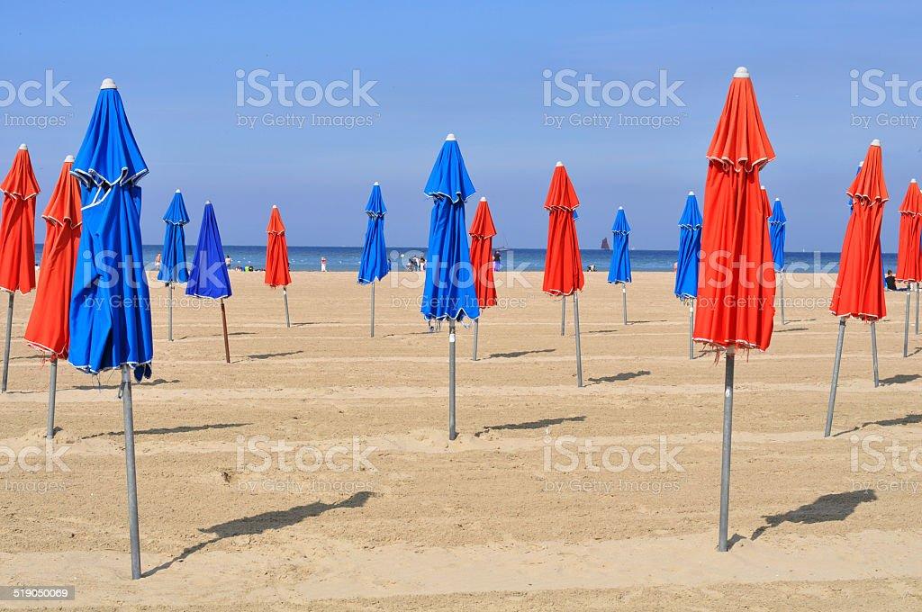 Colorful beach umbrellas in Deauville stock photo