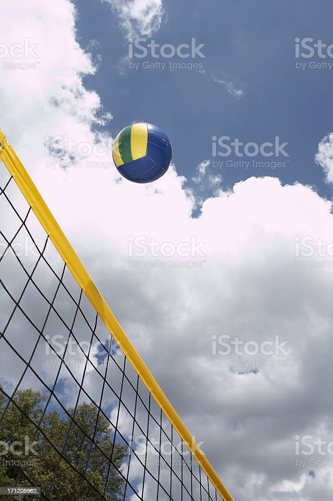 Colorful beach volley net with ball and with blue sky and clouds...