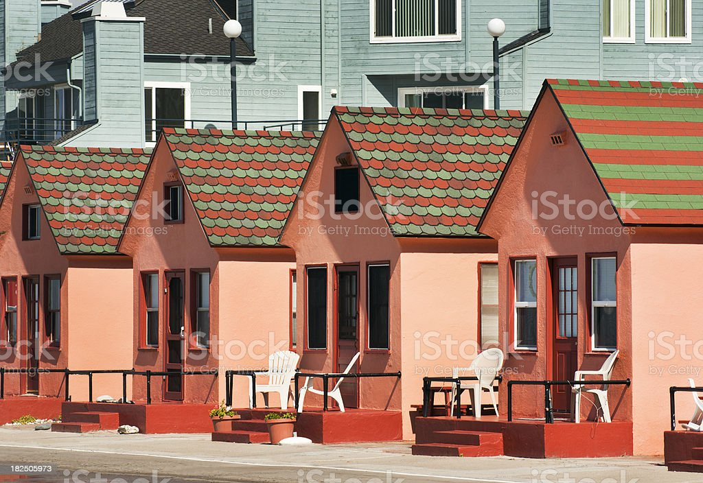 Colorful Beachfront Pink Cottage Cabins in a Row, Oceanside, California royalty-free stock photo