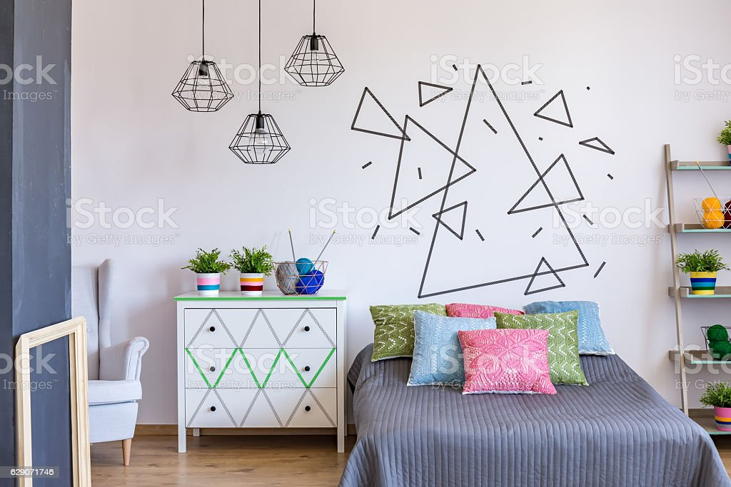 Colorful bedroom with rack with flowers stock photo