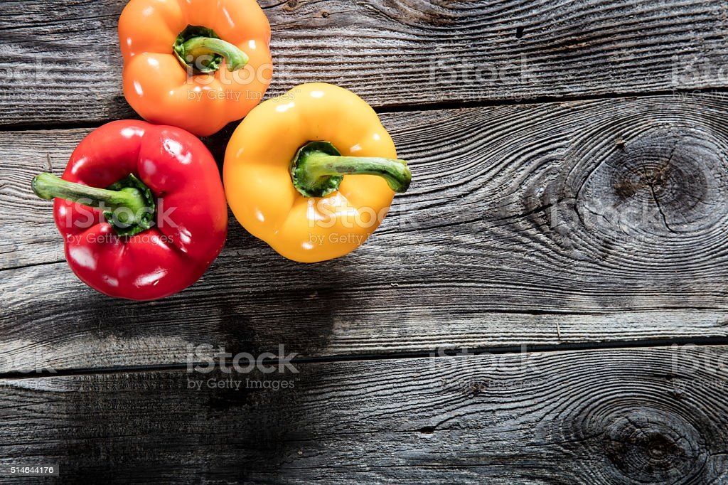 colorful bell peppers on authentic old wood copy space royalty-free stock photo