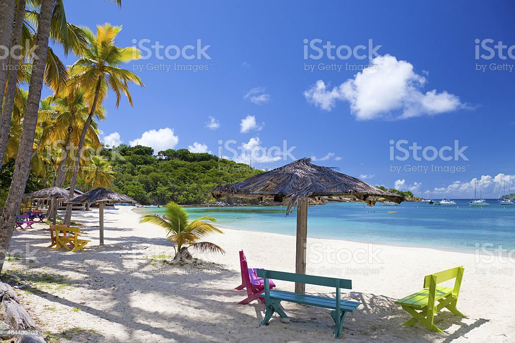 colorful benches at Honeymoon Beach, Water Island, US Virgin Islands stock photo
