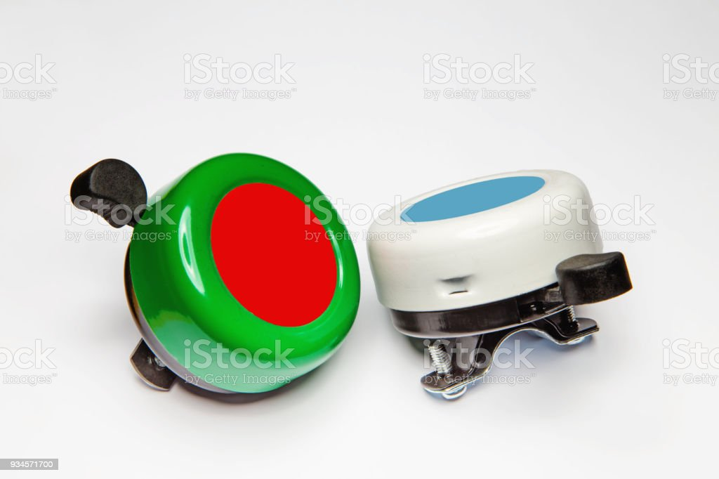 Colorful bicycle bells on a white stock photo