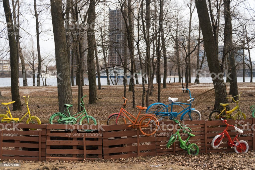 colorful bicycles on the fence royalty-free stock photo