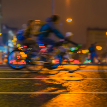 929609038 istock photo Colorful bicyclists on city street. Parade of bicyclists, blur effect, unrecognizable faces. Sport, fitness and healthy lifestyle concept. Intentional motion blur 948683644