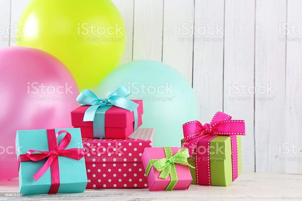 Colorful big party balloons and gift boxes stock photo