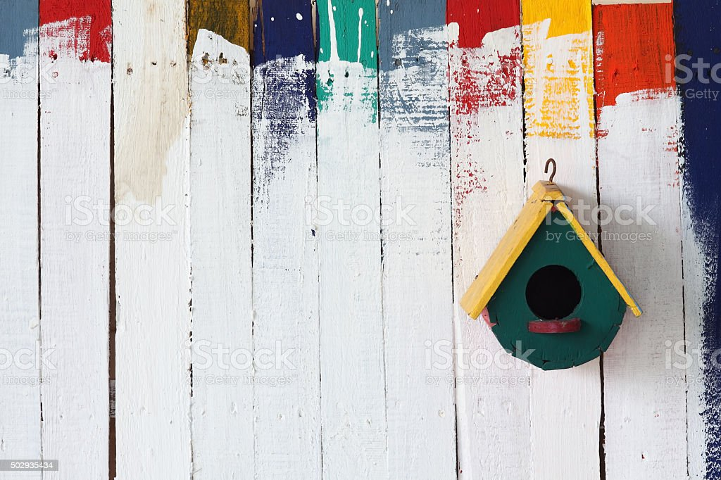 colorful bird house on grunge background. stock photo