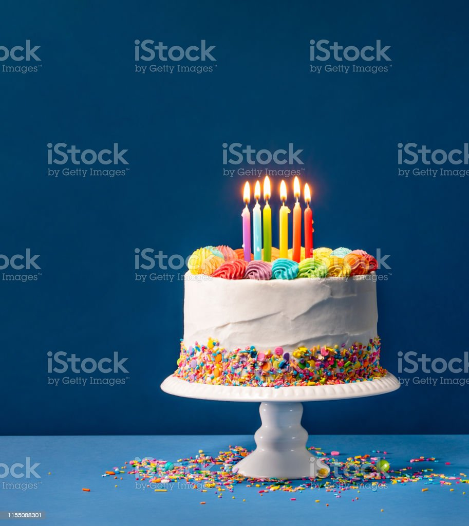 Prime Colorful Birthday Cake Over Blue Stock Photo Download Image Now Funny Birthday Cards Online Chimdamsfinfo