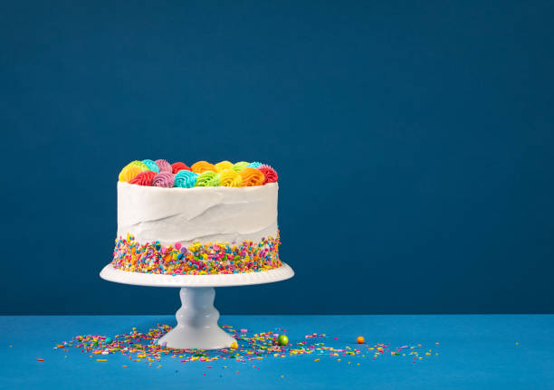 Colorful Birthday Cake over Blue stock photo