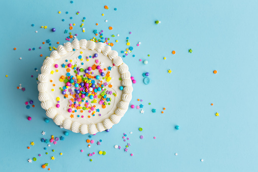 istock Colorful birthday cake top view 1125689900