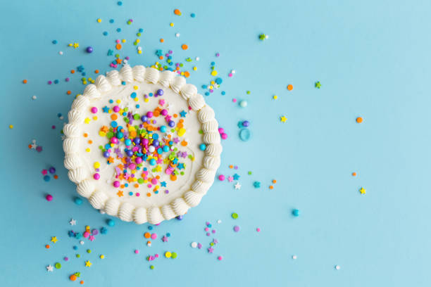 Colorful birthday cake top view Birthday cake top view with colorful sprinkles cake stock pictures, royalty-free photos & images