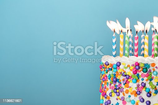 istock Colorful birthday cake with lots of candles 1136621601