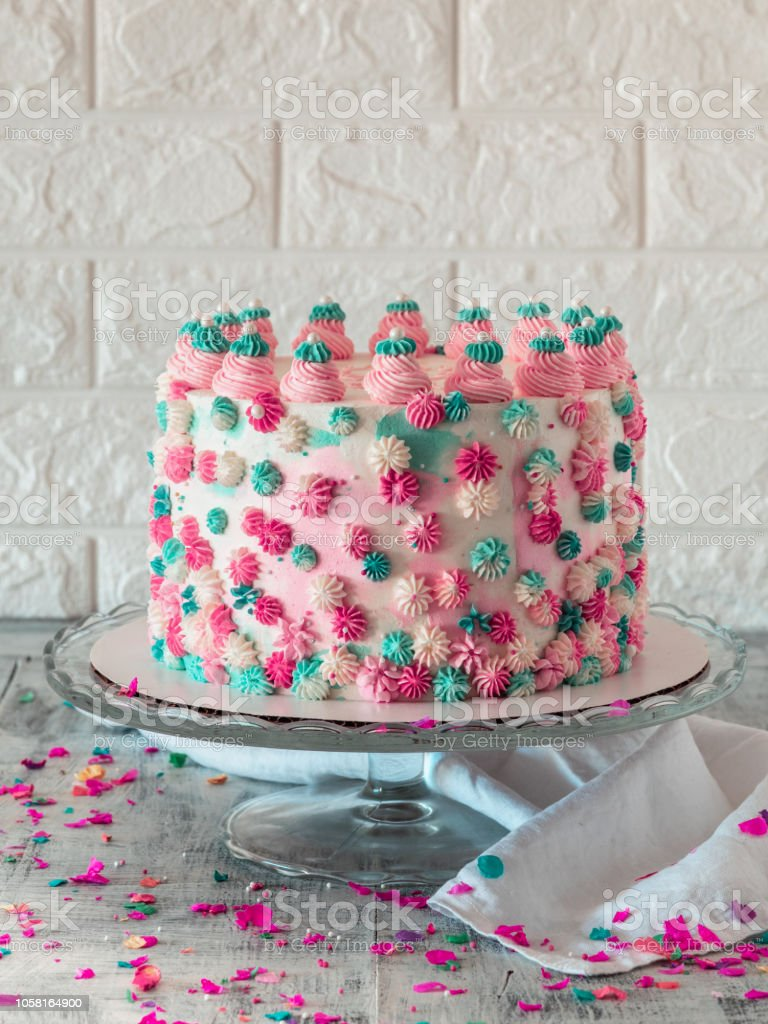 Colorful Birthday Cake With Sprinkles On A Light Background