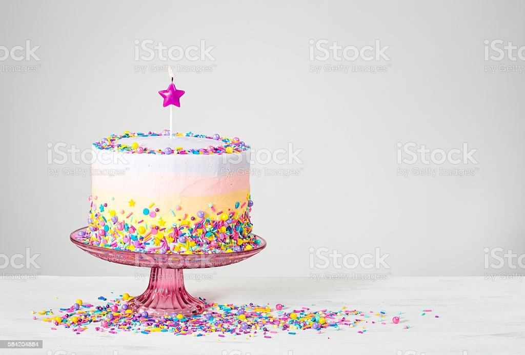 Colorful Birthday Cake with Sprinkles stock photo