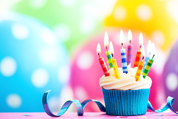 Colorful birthday cupcake stock photo