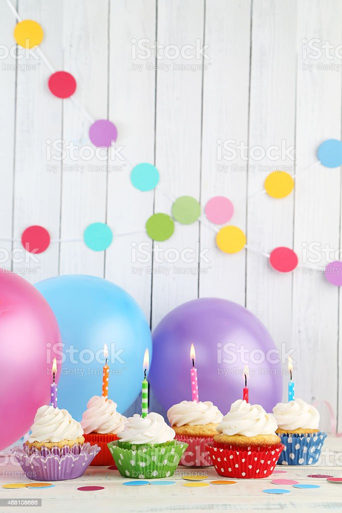 Colorful Birthday Cupcakes Balloons And Decorations