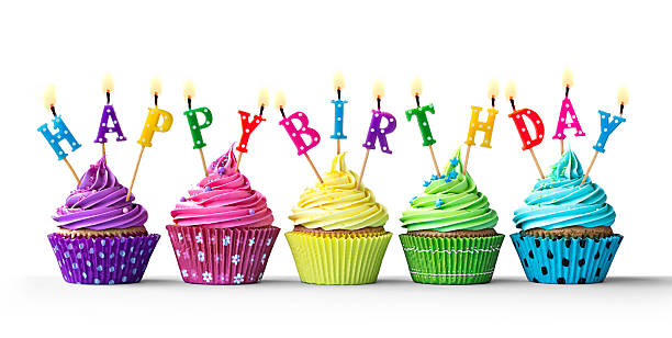 Colorful birthday cupcakes on white stock photo