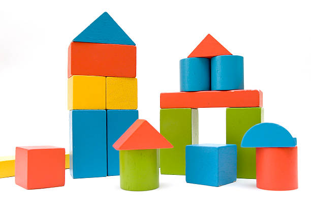 Colorful blocks stacked up like towers stock photo