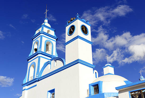 Colorful Blue and white Church with blue sky background, Mexico Colorful blue and white Church with blue sky background located near borders of Veracruz and Puebla, close to Pico de Orizaba, Iztaccihuatland Popocatepetl volcanoes, Mexico orizaba stock pictures, royalty-free photos & images