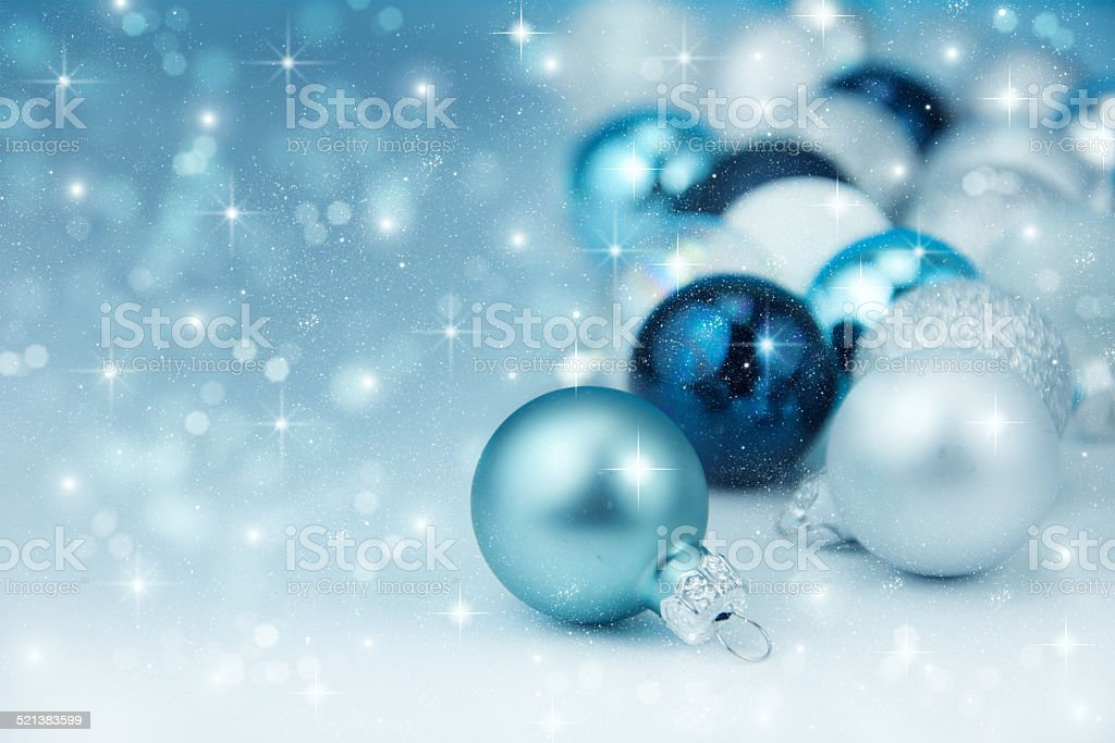 Colorful blue christmas decoration baubles on white. stock photo