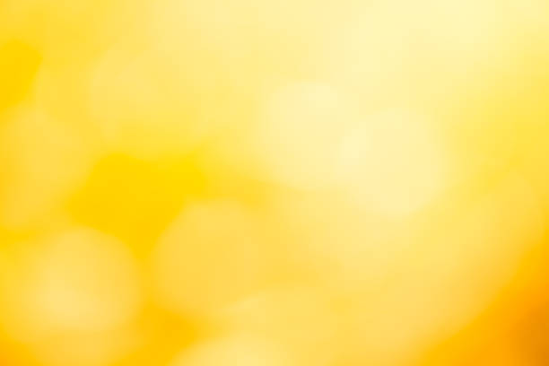 colorful blurred backgrounds,yellow background - brightly lit stock pictures, royalty-free photos & images