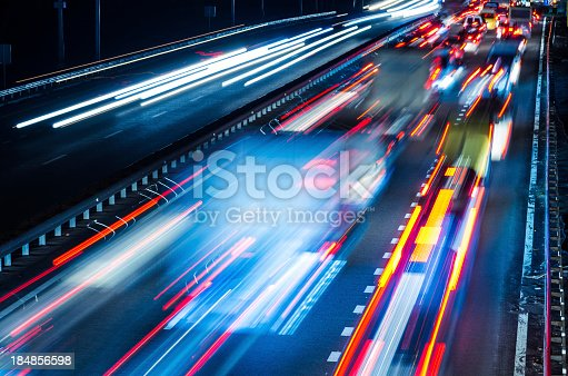 istock Colorful blurred lights of moving traffic at night 184856598