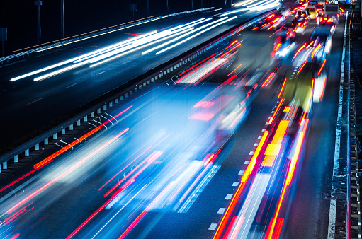 Colorful blurred lights of moving traffic at night