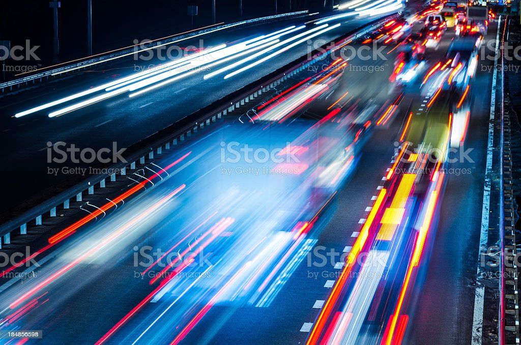 Colorful blurred lights of moving traffic at night stock photo