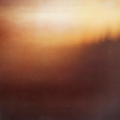 blurry unfocused background with light leaks and grain