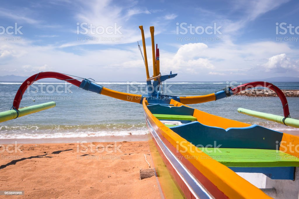 Colorful boat on a balinese beach in front of the sea - Royalty-free Bali Stock Photo