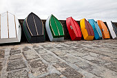 Eight colorful small rowboats standing in the harbor