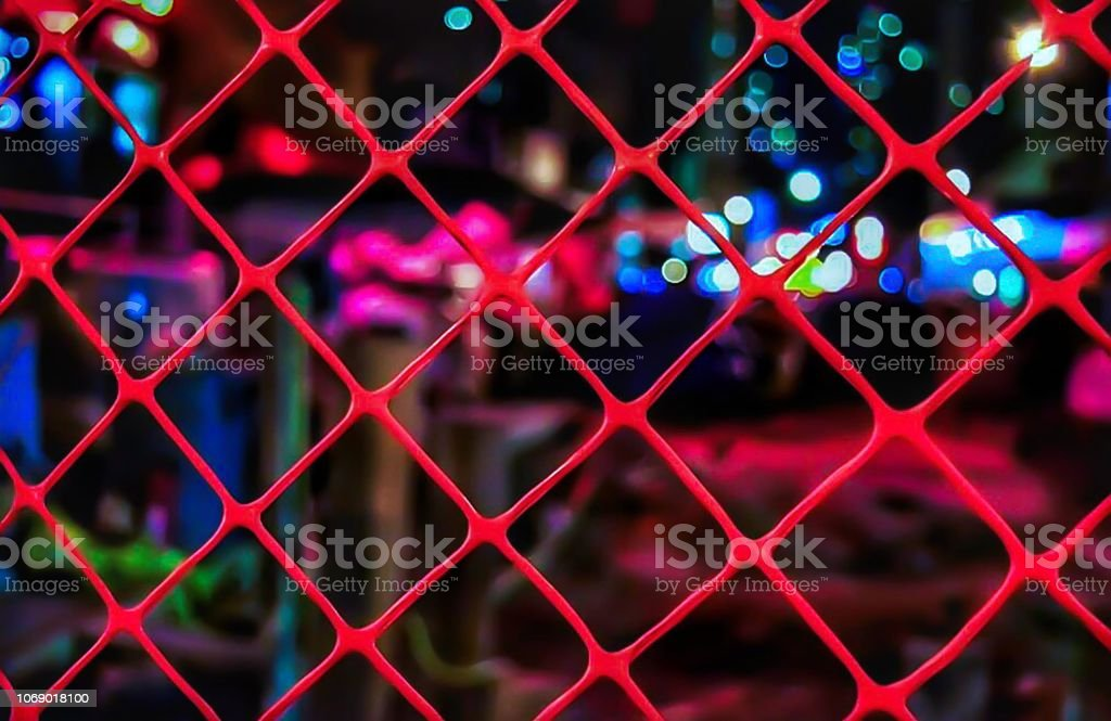Colorful Bokeh and Orange Fence stock photo
