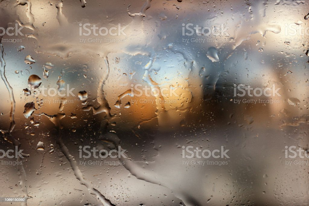 Colorful Bokeh With Street Light At Night Raindrops On Car