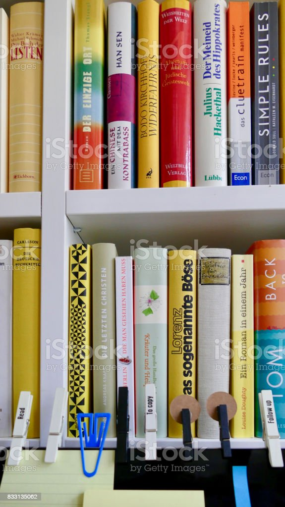 Colorful book shelf with bookmarks on top of screen stock photo