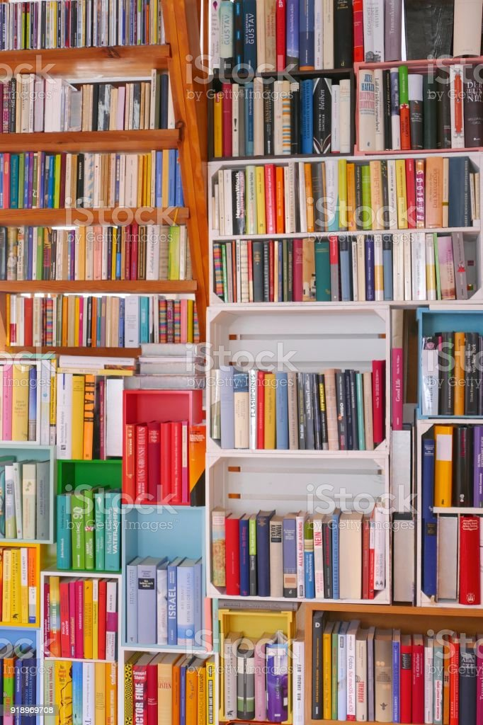 Colorful Book Shelves Packed With Books Stock Photo & More Pictures ...