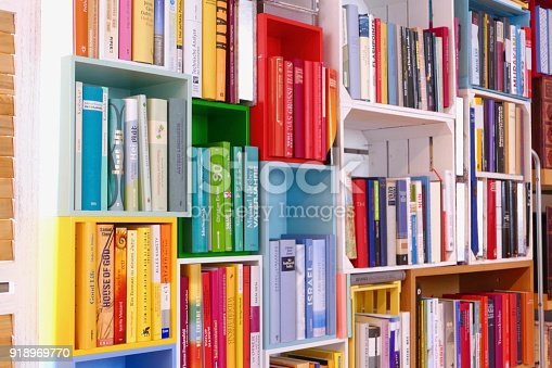 istock Colorful book shelves packed with books 918969770