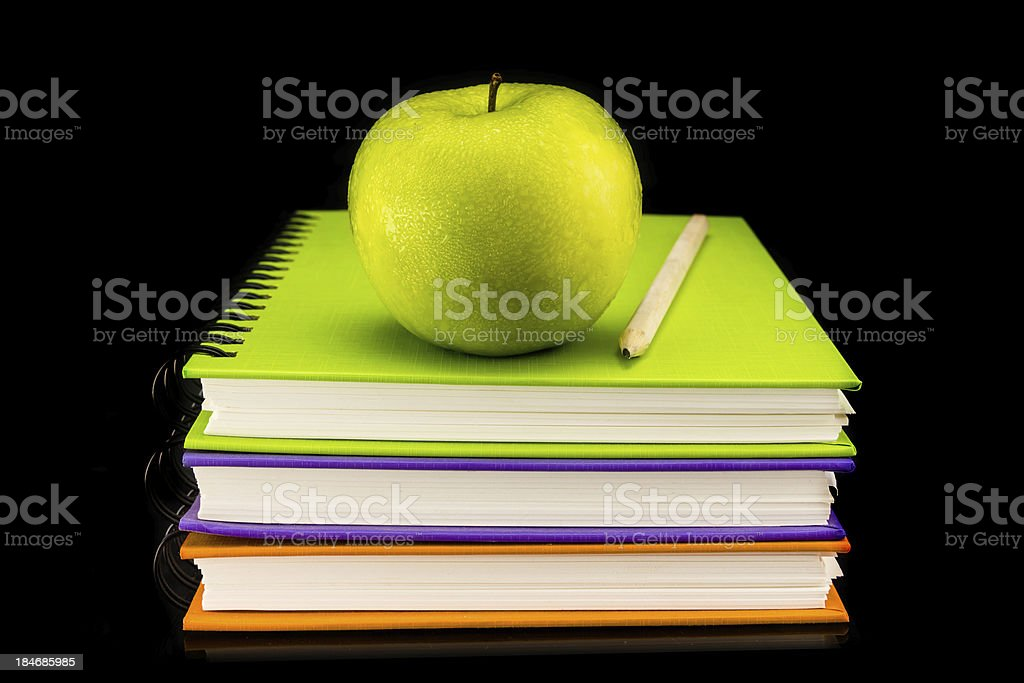 Colorful book with green apple royalty-free stock photo