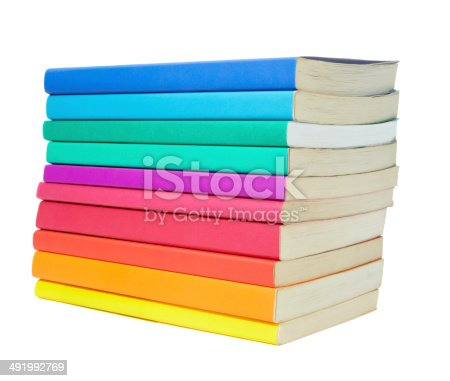close up of stack of colorful books on white background, with clipping path includedclose up of stack of colorful books on white background, with clipping path included