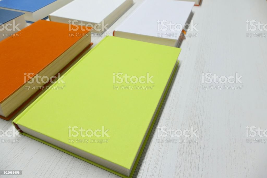 Colorful books with blank titles from above stock photo